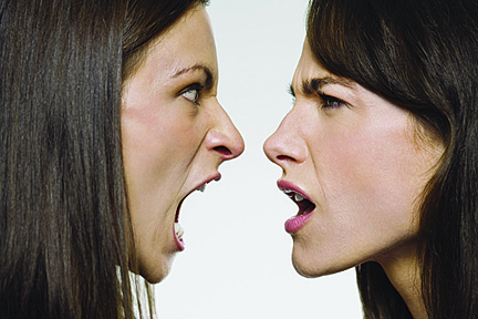 Profile of two women yelling at eachother